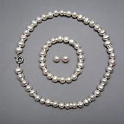 una elegante joyería de perlas de agua dulce conjunto, incluyendo el collar, pulsera y pendientes
