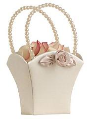 la elegancia en la cesta de marfil niña de las flores