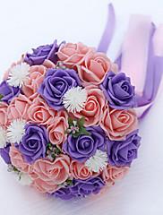 Magnifique bouquet boule composé de roses violettes et rose et ruban de satin