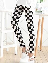 kvinners svart og hvit rutete leggings