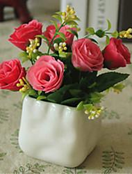 rosa rosa flores artificiales con el florero