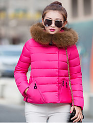 Woman In the long thickening down cotton-padded jacket