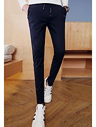 Masculino Skinny Chinos Calças-Cor Única Casual Simples Cintura Média Com Cordão Algodão Micro-Elástico Com Molas / Outono