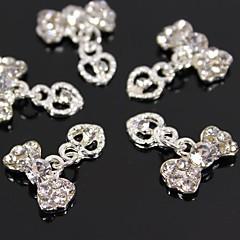 10st zilver strass bowtie met holle hart bengelen 3d legering nail art decoratie