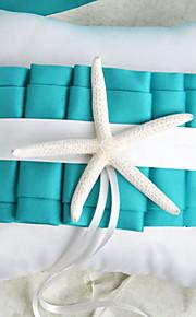 plage sur le thème bleu coussin alliance avec des étoiles de mer